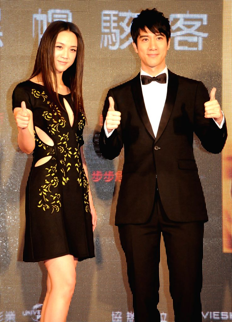 """Actress Tang Wei (L) and actor Leehom Wang pose for photos at the premiere of U.S. movie """"Blackhat"""" in Taipei, southeast China's Taiwan, Jan. 15, 2015. ..."""