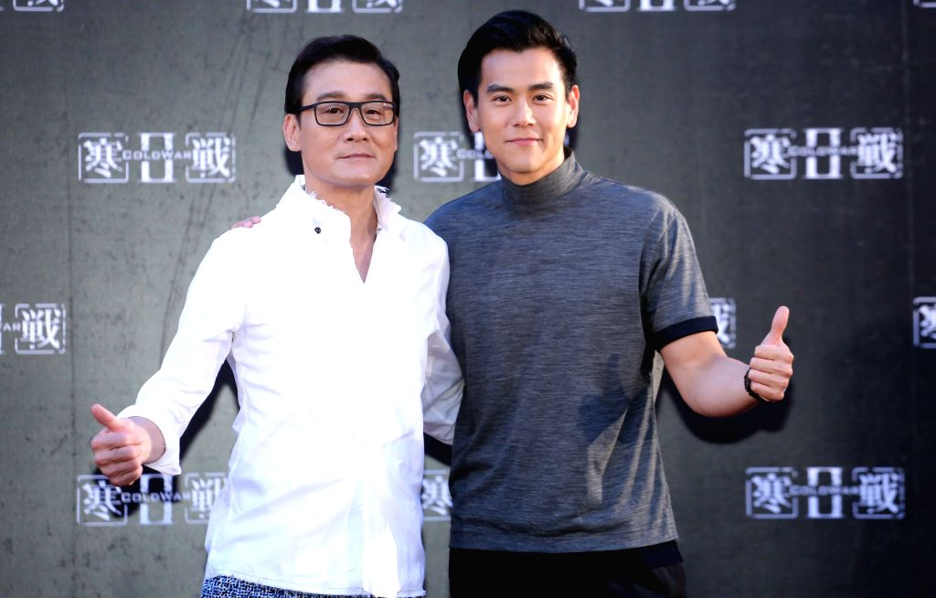 """TAIPEI, June 28, 2016 - Actor Tony Leung Ka Fai (L) and Eddie Peng attend the premiere of the movie """"Cold War 2"""" in Taipei, southeast China's Taiwan, June 28, 2016. The movie is expected to ... - Tony Leung K"""