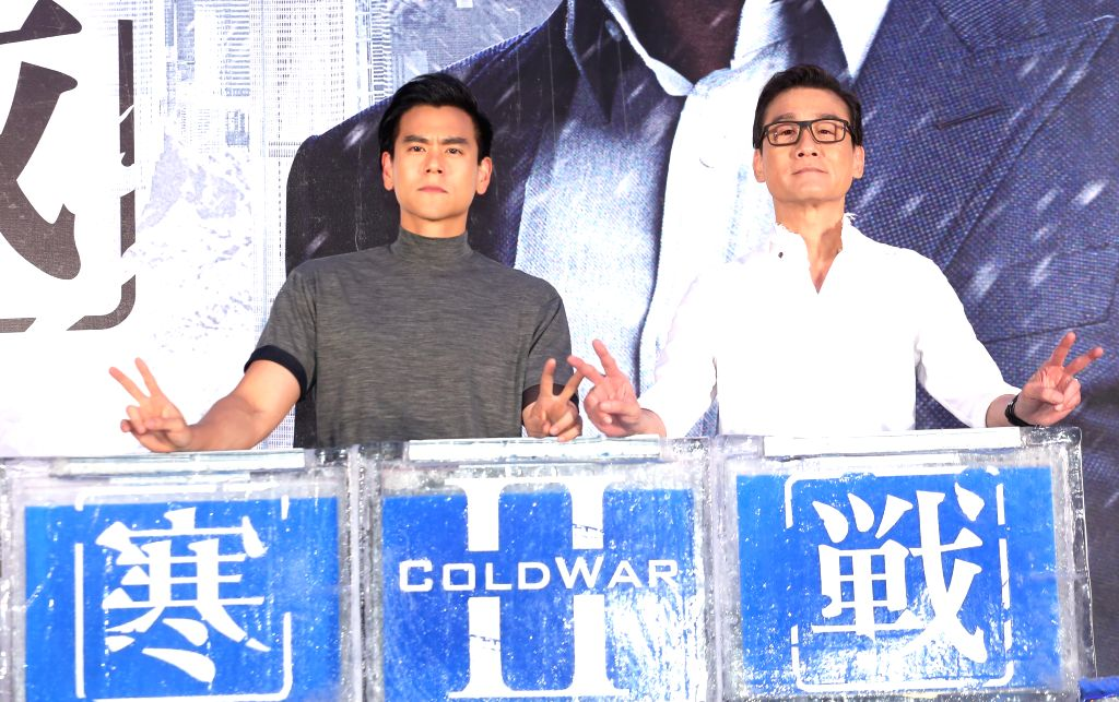 """TAIPEI, June 28, 2016 - Actor Tony Leung Ka Fai (R) and Eddie Peng attend the premiere of the movie """"Cold War 2"""" in Taipei, southeast China's Taiwan, June 28, 2016. The movie is expected to ... - Tony Leung K"""