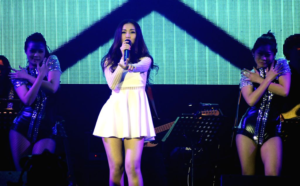 Singer Kay Tse performs at her solo concert in Taipei, southeast China's Taiwan, March 22, 2014.