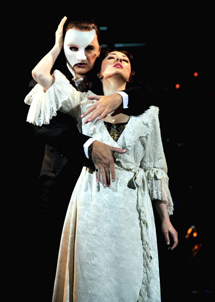 """Leading actor Brad Little and actress Claire Lyon perform at a rehearsal of the musical """"Phantom of the Opera"""" in Taipei, southeast China's Taiwan, Sept. . - Brad Little"""