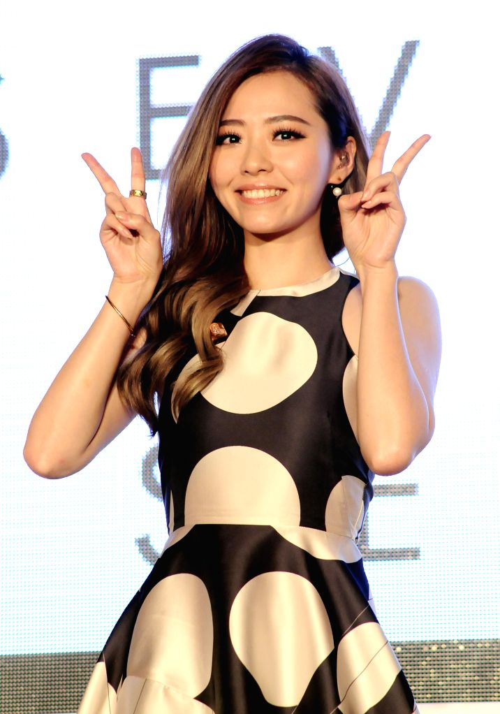Pop singer Zhang Liangying holds a press conference to celebrate the success of her latest records release in Taipei, southeast China's Taiwan, Sept. 12, 2014. ...