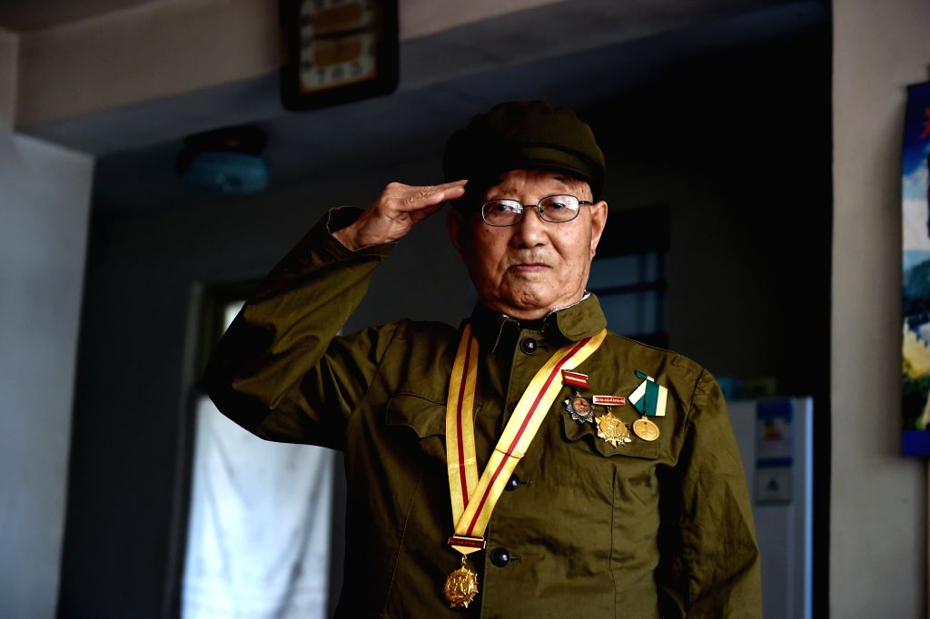 TAIYUAN, July 6, 2017 - Veteran Guo Dehe, 93, salutes at home in Yangquan City, north China's Shanxi Province, May 12, 2017. Guo, born in 1924, joined the Chinese army in 1940 during the ...