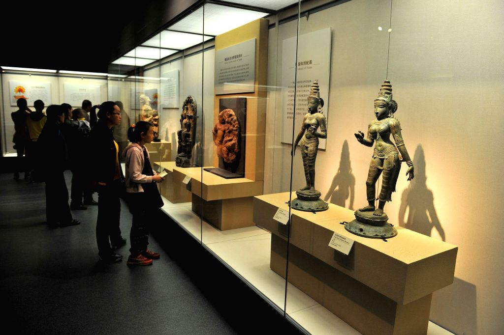 "Visitors look at statues and sculptures displayed at ""India's Universe"", an exhibition of Indian cultural masterworks from the Los Angeles County Museum of ."