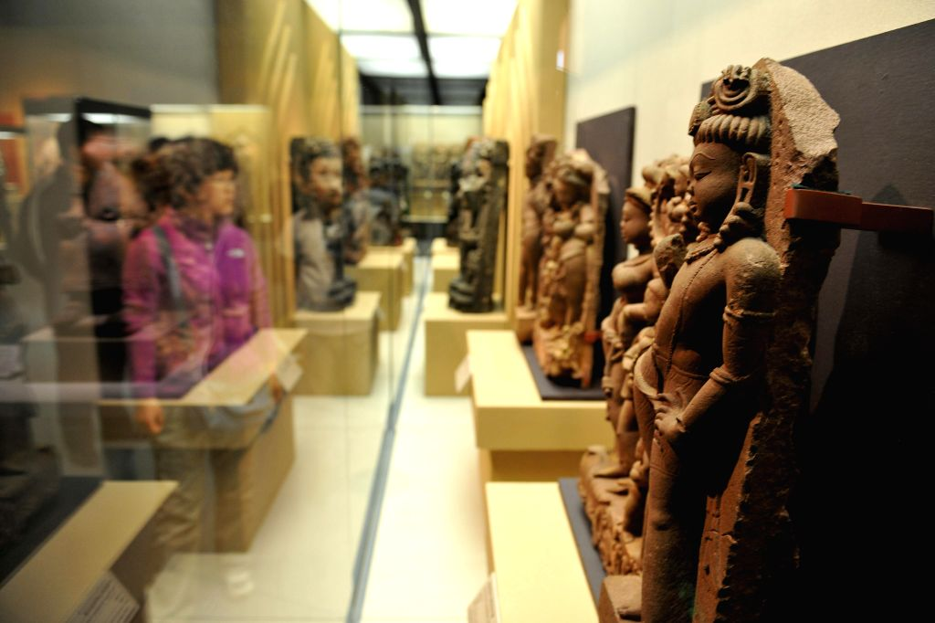 "Visitors look at stone sculptures displayed at ""India's Universe"", an exhibition of Indian cultural masterworks from the Los Angeles County Museum of Art ..."