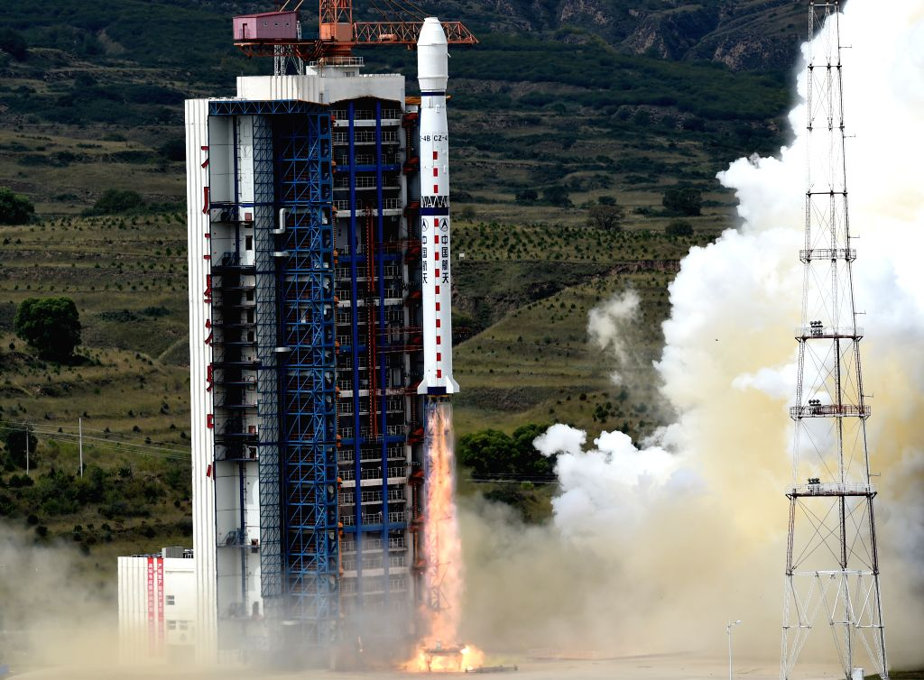 A Long March-4B carrier rocket carrying the Yaogan-21 remote sensing satellite blasts off from the launch pad at the Taiyuan Satellite Launch Center in Taiyuan, ...