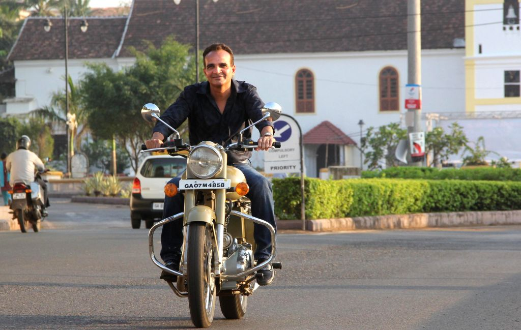Goa Congress MLA, Babush Monserrate who has been expelled from the party enjoys a ride on his bike at Taleigao on March 11, 2015.