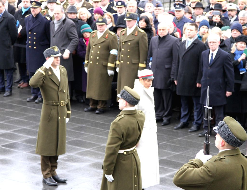 TALLINN, Feb. 24, 2019 - Estonian President Kersti Kaljulaid (C) attends a wreath laying ceremony at the Memorial to the War of Independence in Tallinn, Estonia, Feb. 24, 2019. Celebrations were held ...