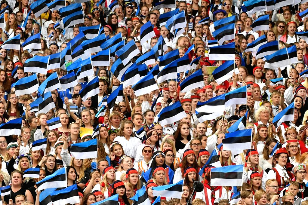 TALLINN, July 3, 2017 - People wave national flags during the 12th Estonian Youth Song and Dance Celebration in Tallinn, Estonia, on July 2, 2017. The joint procession and song celebration Sunday ...