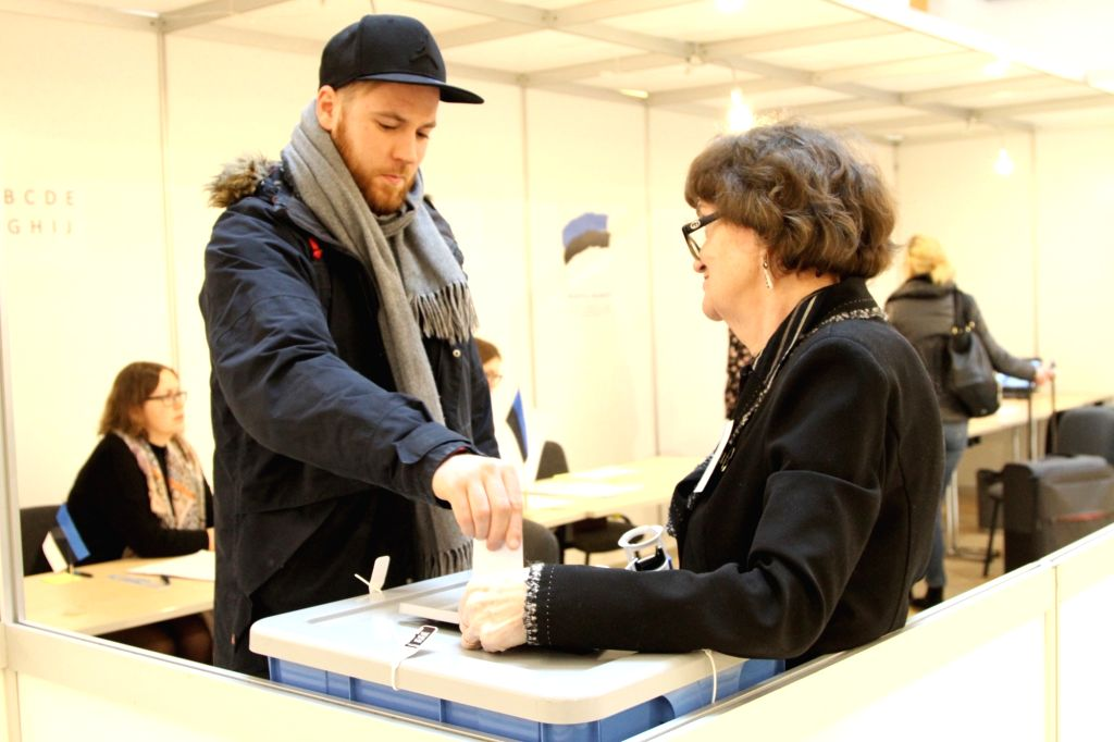 TALLINN, March 3, 2019 - A voter casts a ballot at a polling station at a shopping center in Tallinn, Estonia, on March 3, 2019. Voting of Estonian parliamentary election at polling stations of local ...