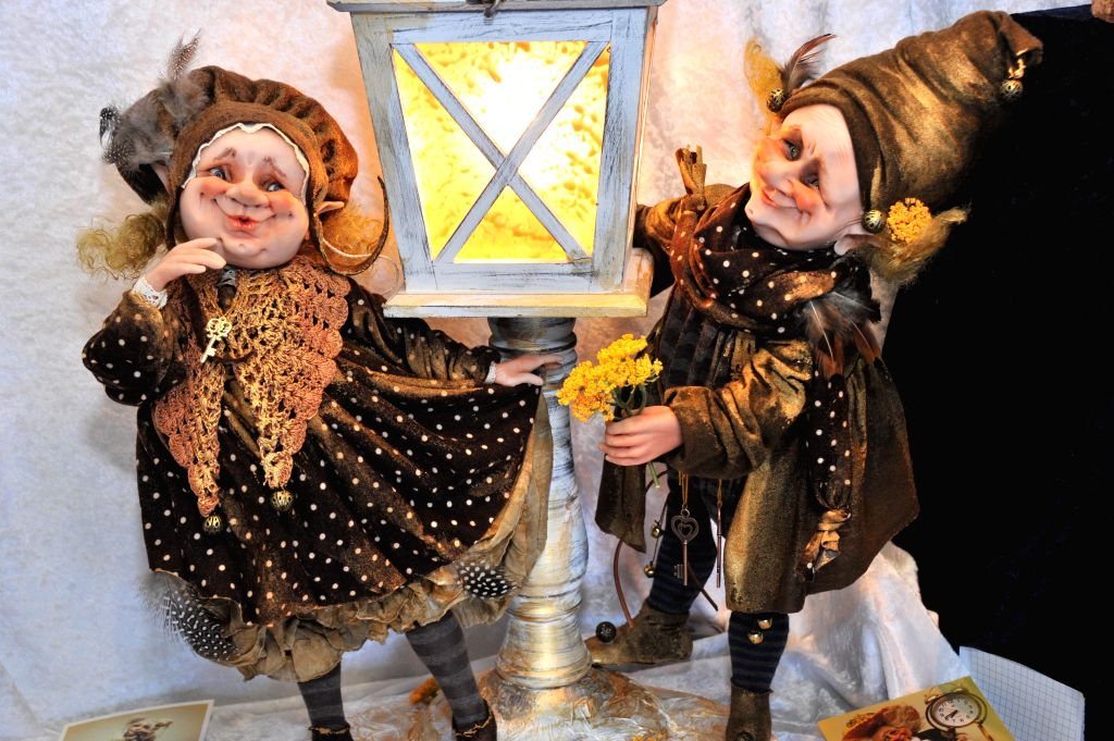 Photo taken on May 2, 2014 shows two exhibit dolls on the Internatinal Charity Doll Exhibition in Tallinn, capital city of Estonia. The exhibition opened on Friday ...