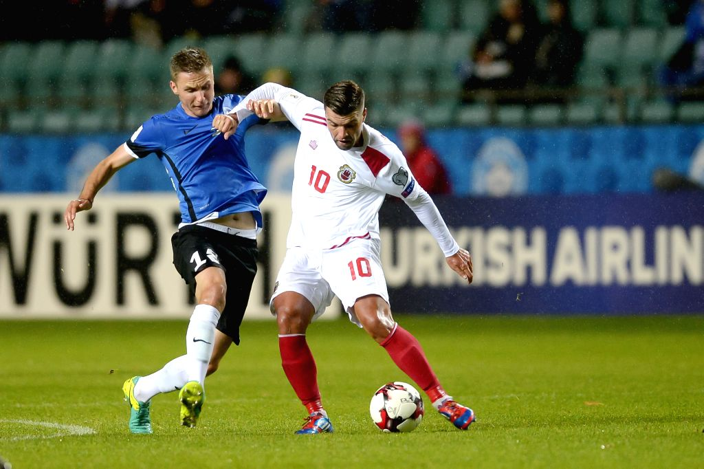 TALLINN, Oct. 8 Karol Mets (L) of Estonia vies with Liam Walker of Gibraltar during their round 1 match at the FIFA World Cup Russia 2018 qualifiers at A Le Coq Arena in Tallinn, Estonia, ...
