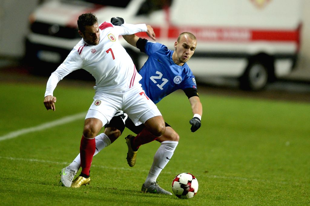 TALLINN, Oct. 8 Lee Casciaro (L) of Gibraltar vies with Nikita Baranov of Estonia during their round 1 match of FIFA World Cup 2018 qualifiers at A Le Coq Arena in Tallinn, Estonia, Oct. ...