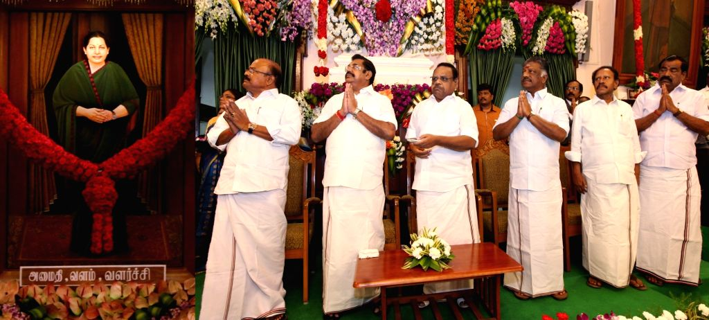 Tamil Nadu Assembly Speaker P. Dhanapal, Chief Minister K. Palaniswami and Deputy Chief Minister O. Panneerselvam unveil the portrait of late former Chief Minister J. Jayalalithaa in the ... - P. Dhanapal