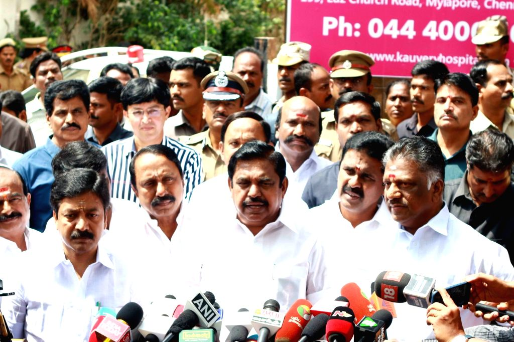 Tamil Nadu Chief Minister E K Palaniswami and deputy Chief Minister O Panneerselvam addressing the crowd outside the Kauvery Hospital where DMK chief M. Karunanidhi is admitted in Chennai on ... - E K Palaniswami