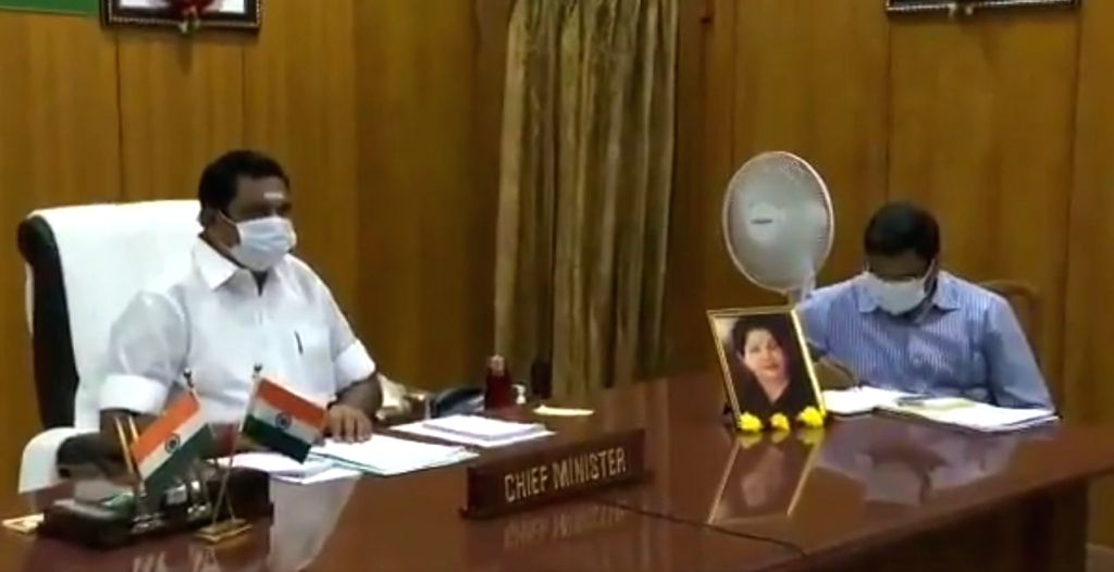Tamil Nadu Chief Minister Edappadi K. Palaniswami attends the 4th interaction with Chief Ministers of all states and Union territories chaired by Prime Minister Narendra Modi through video ... - Edappadi K. Palaniswami and Narendra Modi