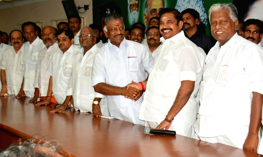 Tamil Nadu Chief Minister Edappadi K. Palaniswami along with the state's former chief minister O. Paneerselvam during the merger of the two factions of AIADMK at the party's headquarters in ... - Edappadi K. Palaniswami
