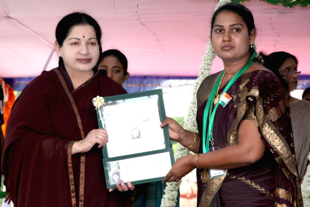 Tamil Nadu Chief Minister J Jayalalithaa presenting the Kalpana Chawla Award for Courage and Daring Enterprise to N Suki Premila of Kanniyakumari district during the Independence Day celebrations in .
