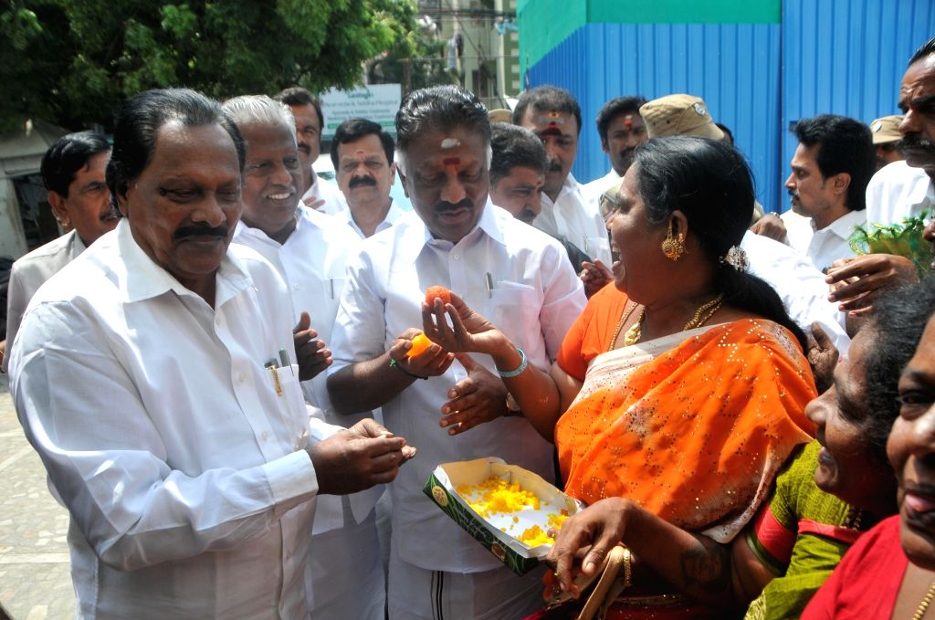 Tamil Nadu Deputy Chief Minister O Panneerselvam exchanges sweets with party workers after the Madras High Court upheld Tamil Nadu Assembly Speaker P. Dhanapal's 2017 decision of ... - O Panneerselvam