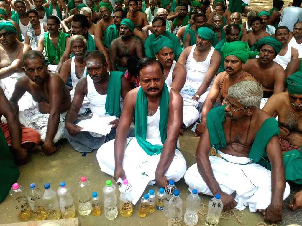 Tamil Nadu farmers protest with their urine bottles to press for their demands at Jantar Mantar in New Delhi on April 22, 2017. Tamil Nadu farmers decided not to drink their urine as ...