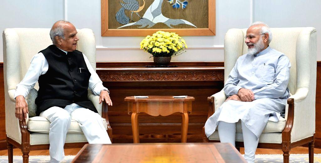 Tamil Nadu Governor Banwarilal Purohit meets Prime Minister Narendra Modi, in New Delhi on Aug 9, 2019. - Narendra Modi