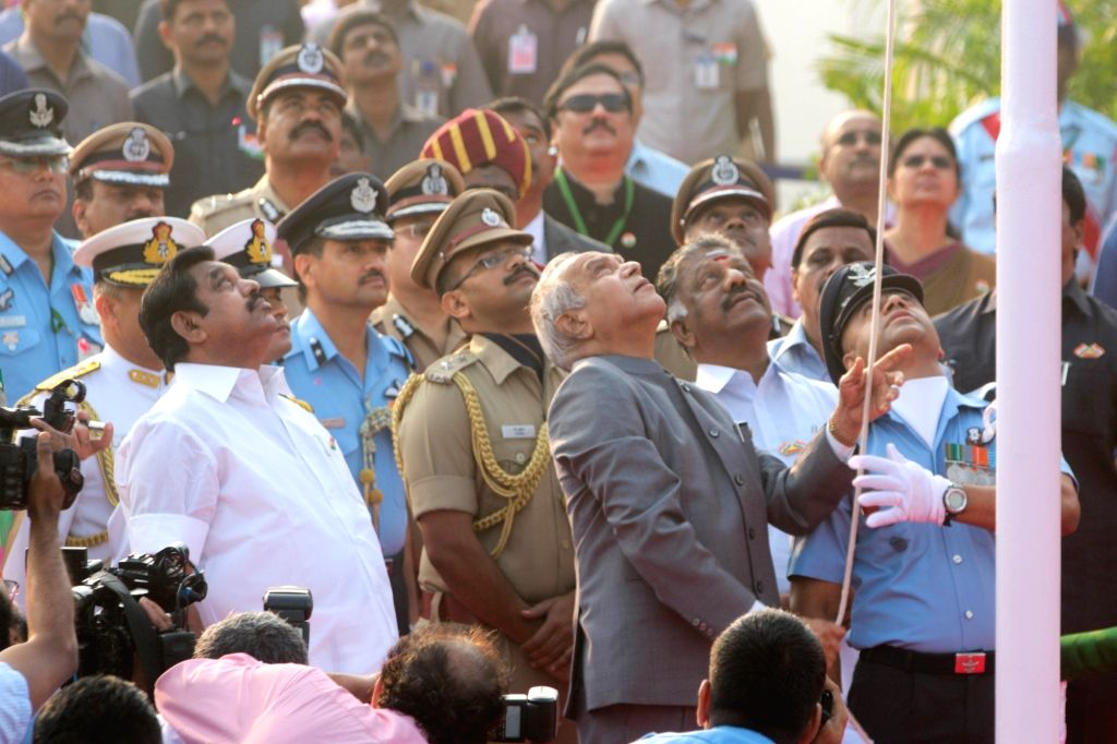 Tamil Nadu Governor Banwarilal Purohit unfurls the tri-colour during Republic Day celebrations in Chennai on Jan 26, 2018. Also seen with Chief Minister K. Palaniswami. - K. Palaniswami