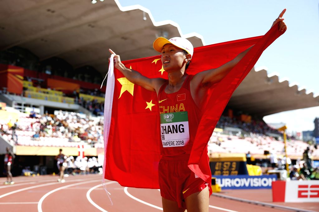 TAMPERE, July 14, 2018 - Zhang Yao of China celebrates after winning the Men's 10,000 Metres Race Walk final at the IAAF (International Association of Athletics Federations) World U20 Championships ...