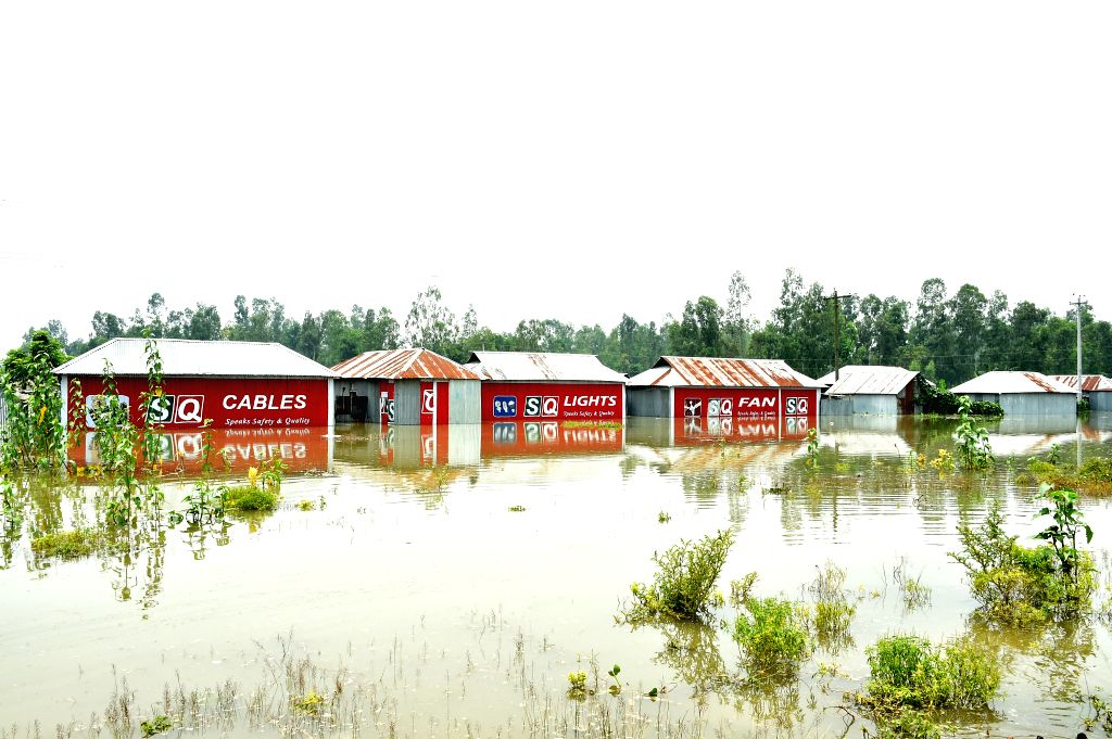 TANGAIL (BANGLADESH), July 18, 2019 Partially submerged houses are pictured in a flood-affected area in Tangail, Bangladesh, on July 18, 2019. Flash floods sparked by heavy seasonal rains ...