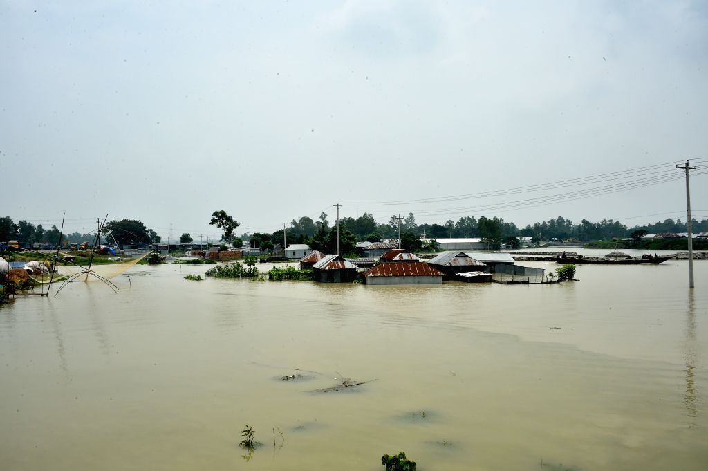 TANGAIL (BANGLADESH), July 18, 2019 (Xinhua) -- Partially submerged houses are pictured in a flood-affected area in Tangail, Bangladesh, on July 18, 2019. Flash floods sparked by heavy seasonal rains affected parts of Bangladesh. (Str/Xinhua/IANS)