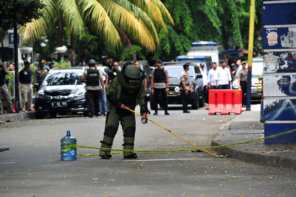 TANGERANG, Oct. 20, 2016 - A member of the Indonesian bomb squad wearing a protective suit inspects the scene of an attack in Tangerang, Banten province, Indonesia, Oct. 20, 2016. A man attacked ...