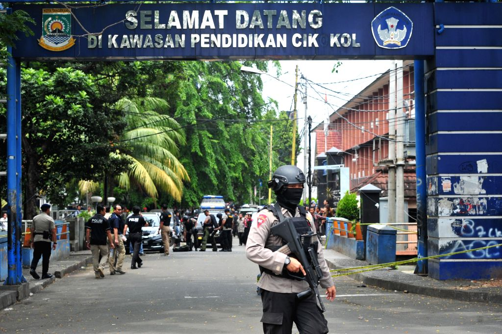 TANGERANG, Oct. 20, 2016 - An Indonesian police stands guard at the scene of an attack in Tangerang, Banten province, Indonesia, Oct. 20, 2016. A man attacked police in the city of Tangerang, Banten ...