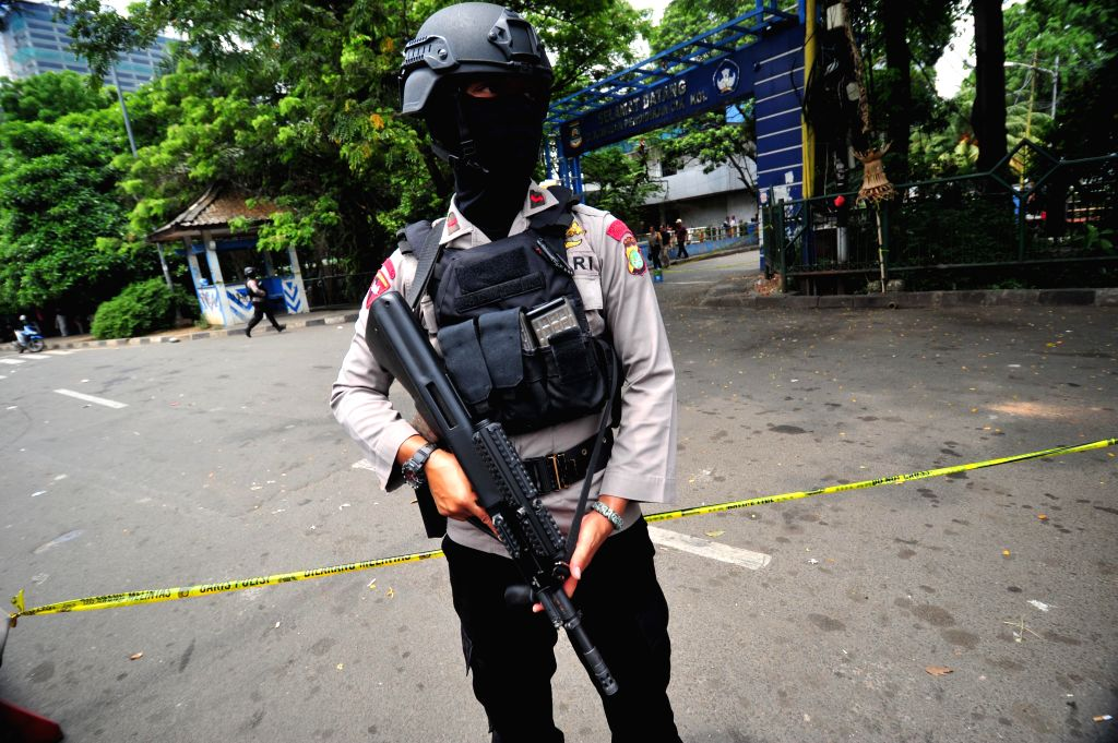TANGERANG, Oct. 20, 2016 - An Indonesian police stands guard at the scene of attack in Tangerang, Banten province, Indonesia, Oct. 20, 2016. A man attacked police in city of Tangerang, Banten ...