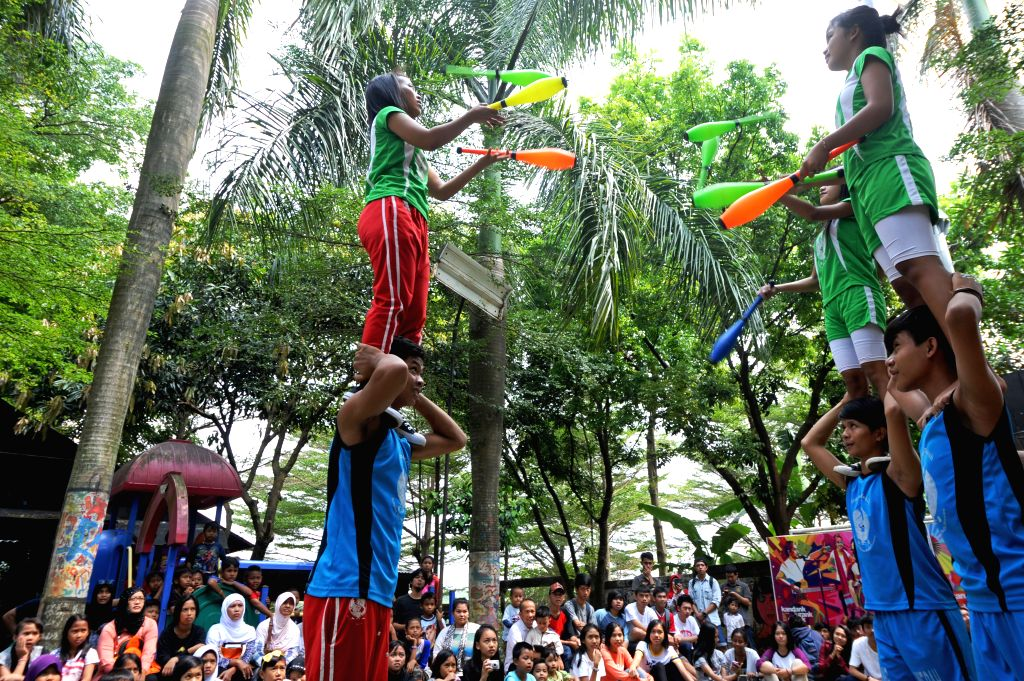 Members of Red Nose circus from North Jakarta perform in front of the creative community Kandank Jurank Doank school of nature at Jurangmangu in Tangerang, ...