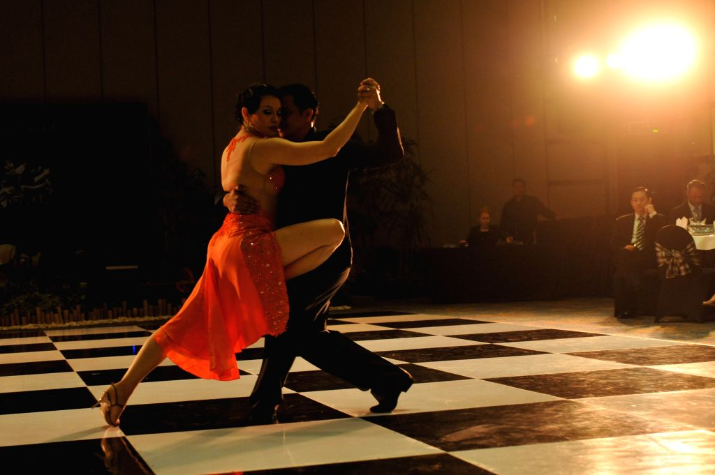 Tango dancers Jorence Altoveros (R) and Jelica Yap from Malaysia perform during the Tango in Paradise Festival 2015 at Denpasar in Bali, Indonesia, Nov. 27, 2015. ...