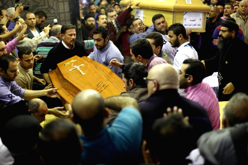 TANTA, April 10, 2017 - People attend the funeral of the church blast victims in Tanta city in Gharbiya province, Egypt, April 9, 2017.  The terrorist attacks that targeted on Sunday two churches in ...