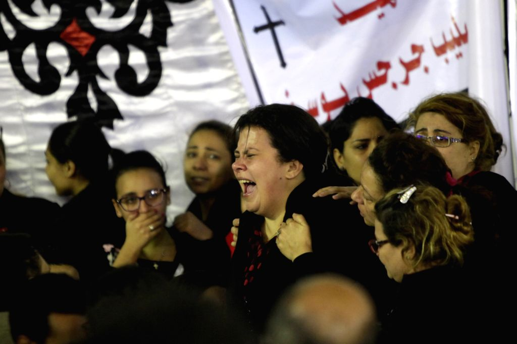TANTA, April 10, 2017 - Relatives cry at the church blast victims' funeral in Tanta city in Gharbiya province, Egypt, April 9, 2017.  The terrorist attacks that targeted on Sunday two churches in the ...