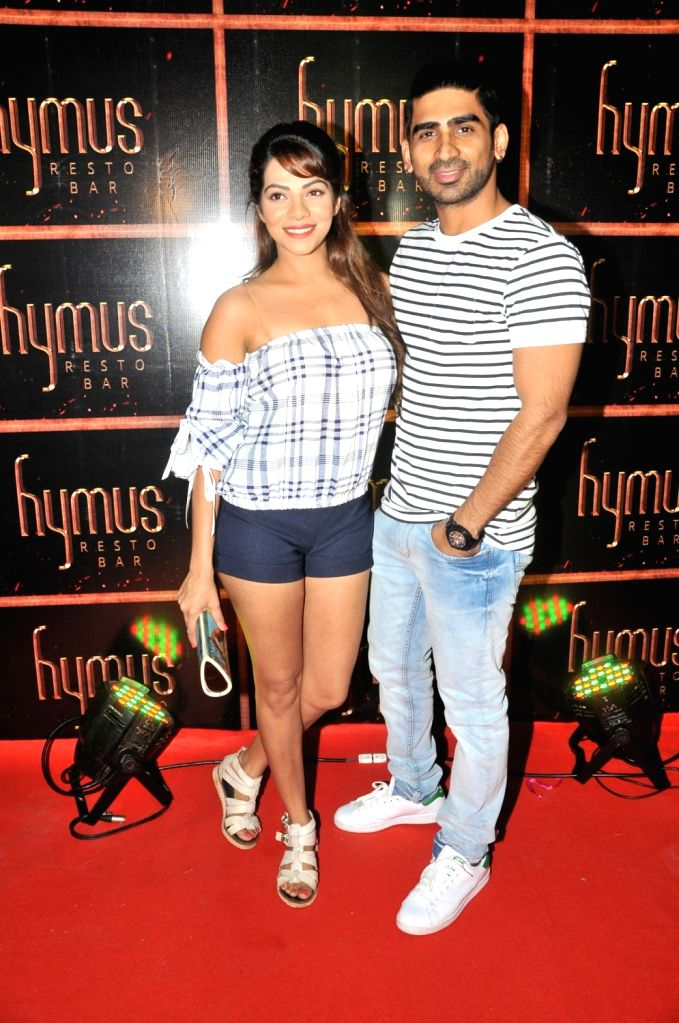 Tanvi Thakkar and Sharad Tripathi during the party organised to celebrate the opening of Hymus Resto Bar in Mumbai, on August 12, 2016. - Sharad Tripathi