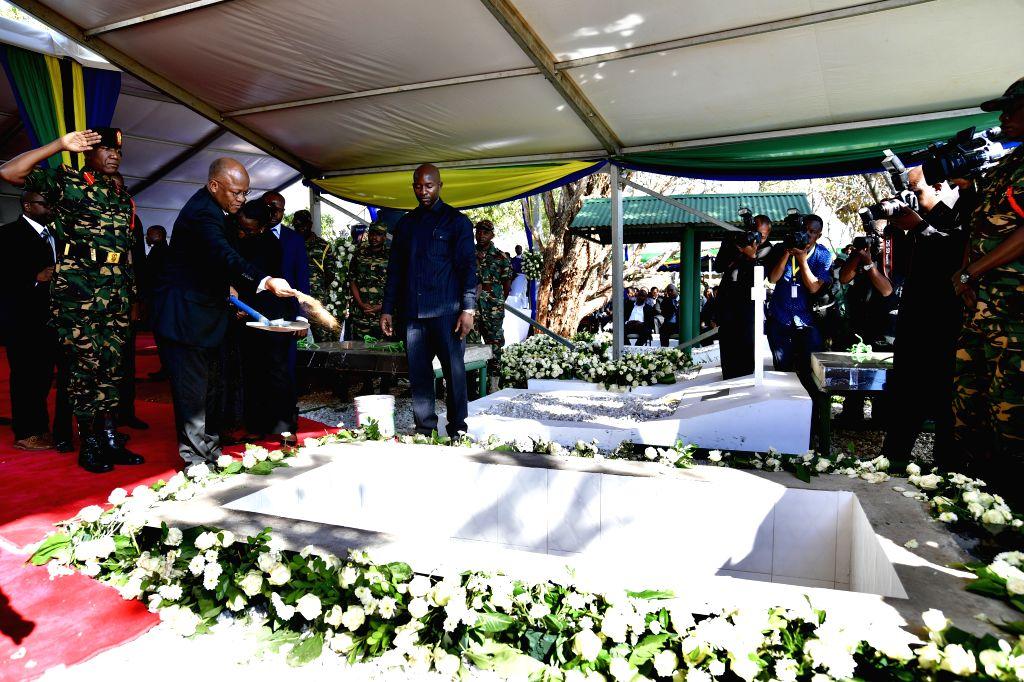 Tanzanian President John Magufuli (2nd L) attends the burial ceremony of former Tanzanian President Benjamin Mkapa in Lupaso village, Masasi district of ...