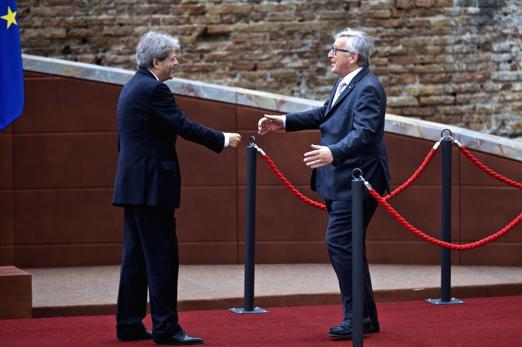 TAORMINA, May 26, 2017 - European Commission President Jean-Claude Juncker (R) embraces Italian Prime Minister Paolo Gentiloni at the ancient Greek theatre of Taormina before the opening ceremony of ... - Paolo Gentiloni