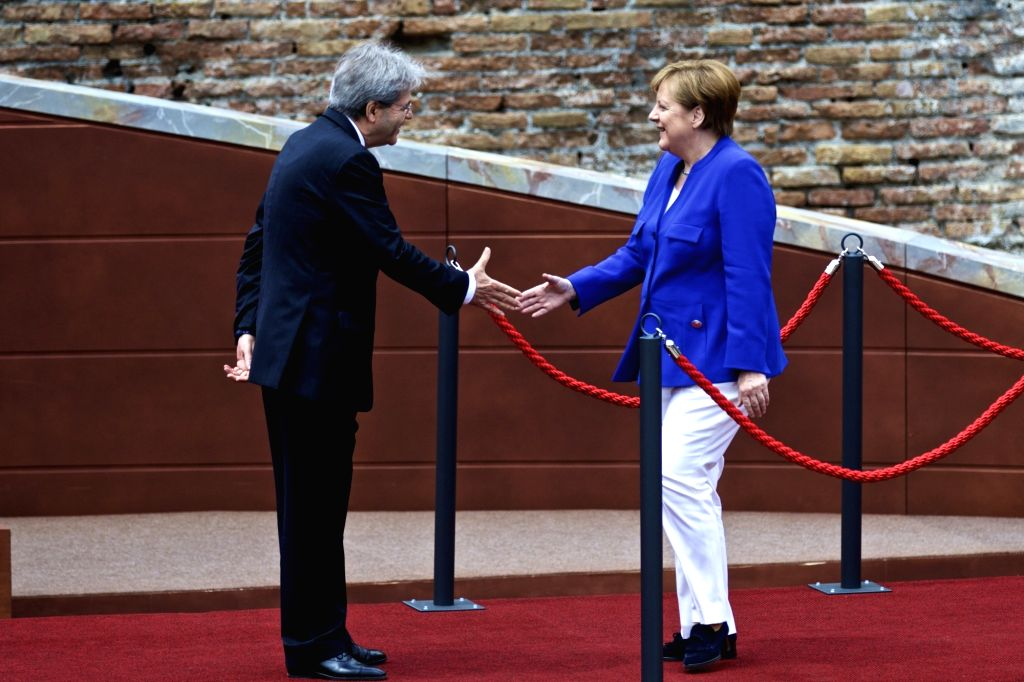 TAORMINA, May 26, 2017 - German chancellor Angela Merkel (R) shakes hands with Italian Prime Minister Paolo Gentiloni at the ancient Greek theatre of Taormina before the opening ceremony of a G7 ... - Paolo Gentiloni
