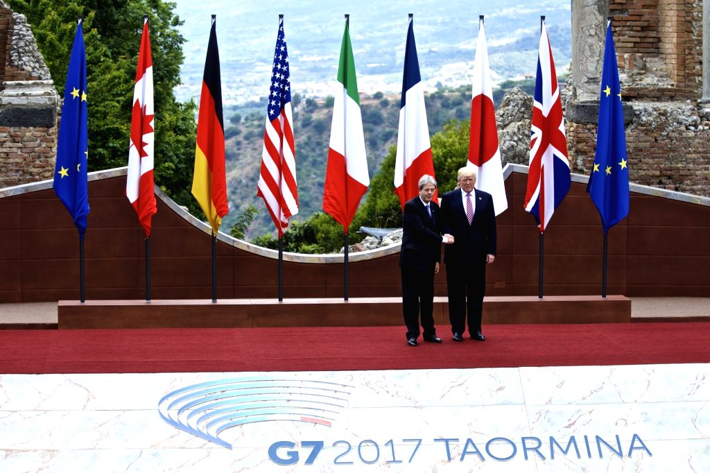 TAORMINA, May 26, 2017 - U.S. President Donald Trump (R) shakes hands with Italian Prime Minister Paolo Gentiloni at the ancient Greek theatre of Taormina before the opening ceremony of a G7 Summit, ... - Paolo Gentiloni