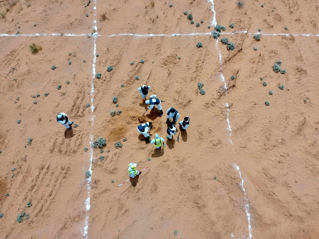 TARHUNA, June 24, 2020 (Xinhua) -- Aerial photo taken on June 23, 2020 shows a team of experts work at the site of the mass graves in Tarhuna, some 90 km south of Tripoli, Libya. Lutfi Al-Misurati, director of the Department of Search for Remains of