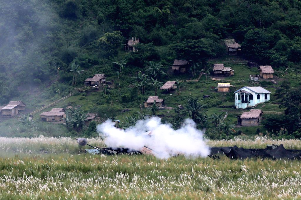 TARLAC PROVINCE, Oct. 10, 2016 - 105mm howitzers are fired near a village during a joint live fire military exercise between the U.S. and the Philippines as part of the 2016 Amphibious Landing ...