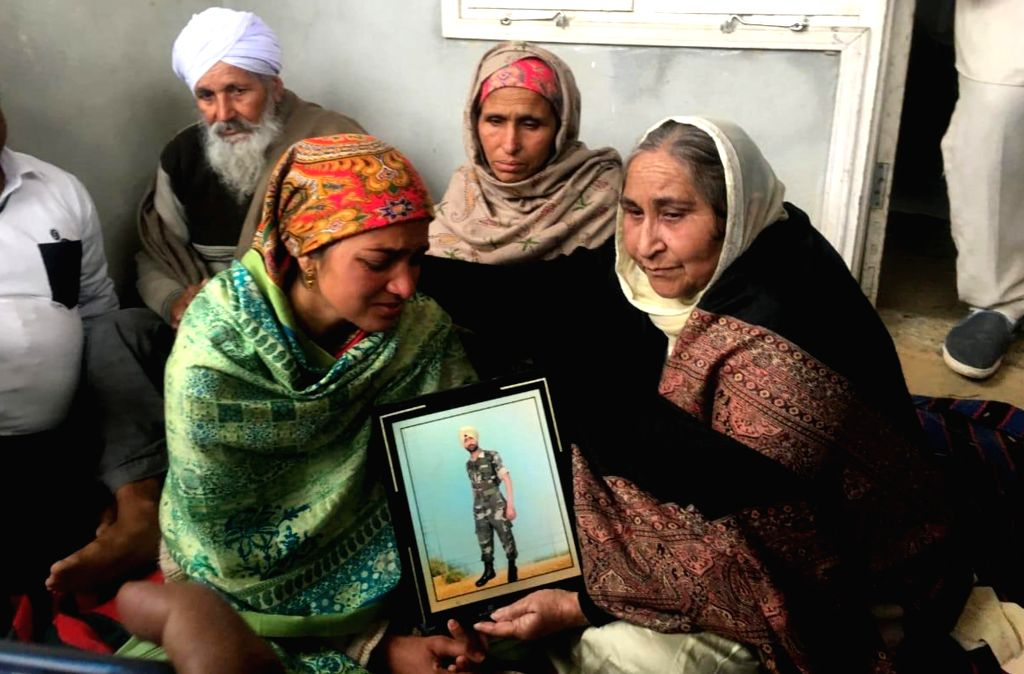 Tarn Taran: Grief struck family members of Sukhjinder Singh, one of the 45 CRPF personnel killed in a suicide attack by militants in Jammu and Kashmir's Pulwama district on 14th Feb 2019; in Punjab's ... - Sukhjinder Singh