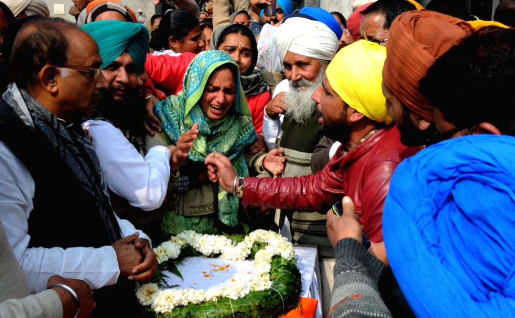 Tarn Taran: Grief struck family members of Sukhjinder Singh, one of the 49 CRPF personnel killed in a suicide attack by militants in Jammu and Kashmir's Pulwama district on 14th Feb 2019; in Punjab's ... - Sukhjinder Singh