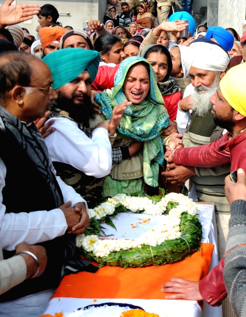 Tarn Taran: Grief struck family members of Sukhjinder Singh, one of the 49 CRPF personnel killed in a suicide attack by militants in Jammu and Kashmir's Pulwama district on 14th Feb 2019; in Punjab's Tarn Taran district, on Feb 16, 2019. (Photo: IANS - Sukhjinder Singh