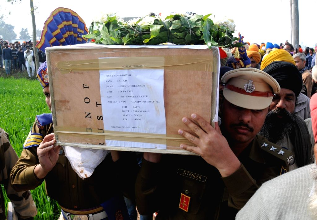Tarn Taran: Last rites of Sukhjinder Singh, one of the 49 CRPF personnel killed in a suicide attack by militants in Jammu and Kashmir's Pulwama district on 14th Feb 2019, underway in Tarn Taran, ... - Sukhjinder Singh