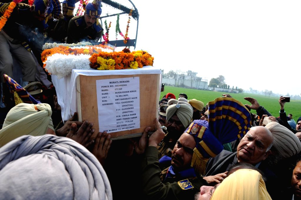 Tarn Taran: Last rites of Sukhjinder Singh, one of the 49 CRPF personnel killed in a suicide attack by militants in Jammu and Kashmir's Pulwama district on 14th Feb 2019, underway in Tarn Taran, Punjab on Feb 16, 2019. (Photo: IANS) - Sukhjinder Singh
