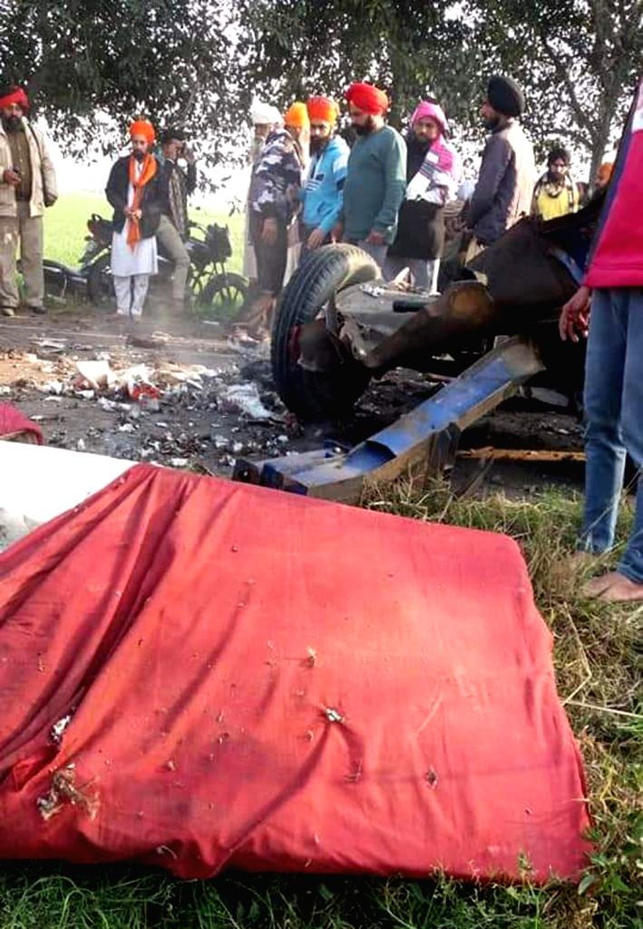 Tarn Taran: Locals gather at the site where a tractor trolley carrying fire crackers caught fire and exploded accidentally during a Nagar Kirtan procession in Punjab's Tarn Taran Sahib on Feb 8, 2020. Reportedly, two persons were killed and over a do