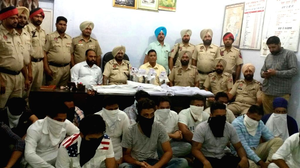 Tarn Taran: Police present before the press 15 persons along with weapons recovered from them in Taran Taran on Sept 23, 2016. Reportedly they were planning a robbery.